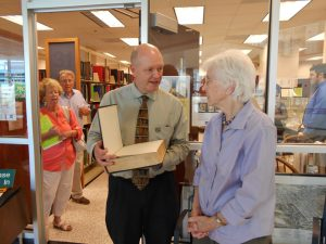 member Peggy Taylor gives Bible to NC Room